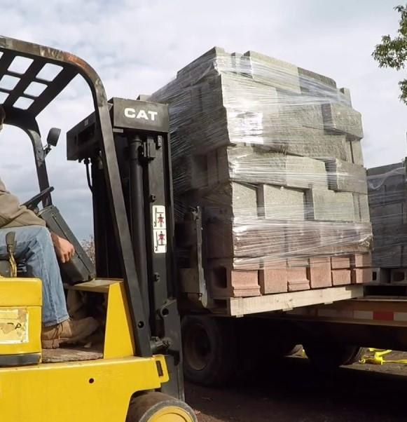 employee loading bricks